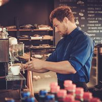 handsome-barista-preparing-cup-of-coffee-for-PDU87MM